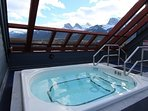 Soak in the rooftop hot tub under a starry or snowy sky.