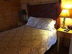 Queen bed with barn door headboard
