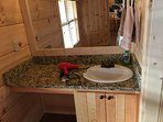 Bathroom sink with granite countertop and makeup area!