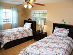 twin bed room with tiles and HD TV