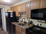 Kitchenette. Stove fridge, microwave, dishes, all cooking utensils