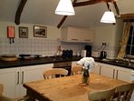 Kitchen with cooker, fridge, freezer, washing mahine, dish washer and microwave.