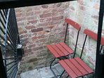 Outdoor sitting area accessed by opening fire gate in bedroom 1.
