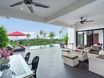 Covered outdoor lounge and dining area for day time sun protection and alfresco dining
