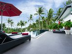 Relax and enjoy the view of the palm tree tops in the breeze