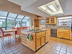 The fully equipped kitchen offers ample counter space to prepare meals.