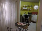 Two seater dining table and view of kitchen
