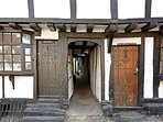 Henry VIII cottage is accessed through a medieval passageway between Anne Boleyn and Tudor Cottages