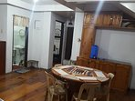 Dining area and partial view of toilet. Flooring is made of polyurethane coated pine wood.