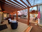 Large pergola deck and dining area overlooking large private courtyard