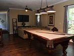Pool table and large HDTV in living area