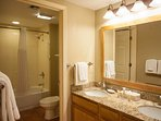 The second bathroom has plenty of space, and includes a full-sized shower