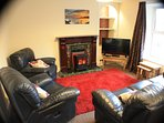 A large lounge with comfortable reclining seating ...and with fine views across the valley.