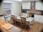 A spacious modern kitchen with plenty of storage space . Fridge,freezer, microwave etc..etc..