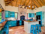 Purpose built kitchen with cabinets the color o the ocean!