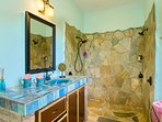 master bath with stone shower and hand crafted tile and wash basin, made in BVI!