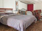 Large comfortable queen bed in studio.