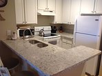 This newly remodeled kitchen with quartz countertops will make cooking enjoyable. We supply coffee.