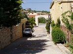 Private road of the Christina Villas complex, leading to the village square.