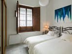 Bedroom. The window faces calle Valladares - a quiet pedestrian street without car traffic.
