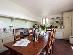 The kitchen with large gas cooker , microwave and fridge freezer