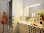 The garden and children's bedrooms share this bathroom with shower and small but deep bath