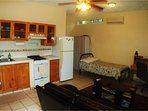 The 1BR ground floor has an extra twin bed in the living area.