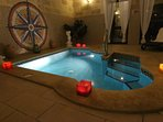Heated indoor pool by night