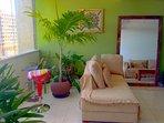 Living / dining room, ceiling fan, Satellite TV, internet, DVD, and sofas.