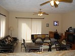The living room is spacious and comfortable, with TV, 2 couches, and work station.