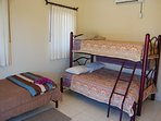 The guest bedroom has 2 twin beds and a double.