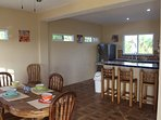 Dining area, breakfast bar and kitchen.