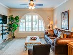 Front living room with large arched window for lots of light