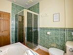 First-floor shared bathroom with shower enclosure. Located between the double and twin bedroom