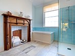 Large bathroom with low level, walk-in shower and underfloor heating. Next to ground floor bedroom