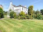 Hanover Cottage is an impressive detached house with beautiful gardens and private parking