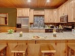 Open kitchen with granite countertops, the latest in appliances and bar seating