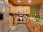 Spacious kitchen with granite countertops and the latest in appliances