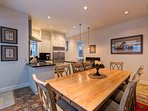 The dining room is conveniently adjacent to the kitchen for easy dining.