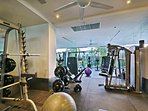 The gym, located on the 1st of the half floors, is fully equipped with weights and treadmills.