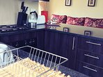 Granite top fully equipped luxury kitchen.