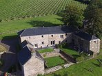 The Courtyard is a suntrap - The right barn houses the pool and a double bedroom via a link bridge.