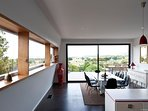 Sweeping vistas of water and irrigated vineyards from every room