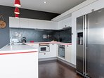Designer kitchen with AEG oven, induction stove, dishwasher, icemaker fridge...