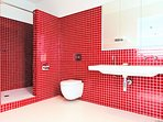 The stunning ensuite in the penthouse suite has twin showers