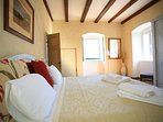 Thick stone walls and high ceilings keep the rooms naturally cool. There is an air conditioning unit