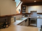 Kitchen with fridge, freezer, dishwasher, cooker, microwave, kettle , toaster and bread machine.