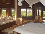The upstairs bedroom has a private balcony offering gorgeous views.