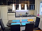 Fully equipped and modern kitchen with dining table and 4 chairs.