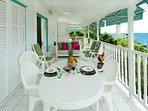 la terrasse est le lieu de vie, vue sur la mer et le village, canapé, fauteuils, hamac, coin repas.